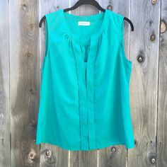 NWOT Calvin Klein Pleated Top Color: Shallow Sea. Great color for spring! Measurements upon request.  Offers are always welcomed unless specified otherwise Discounted bundles (ask for a quote) I only quote bundles No trades for this item No any other outside transactions Calvin Klein Tops