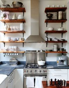Lots of timber shelves in this tiny kitchen