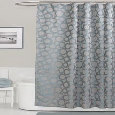 Make taking a shower more fun with this blue shower curtain that transforms your bathroom into a work of art. The contemporary circle pattern brings to mind bubbles in a pond, and the polyester surface keeps stray splashes inside the shower.