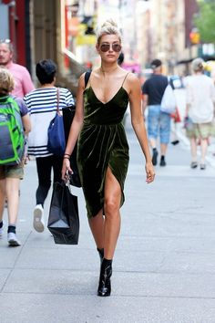 Hailey Balwin sets a trend for the fall in a velvet dress and ankle boots