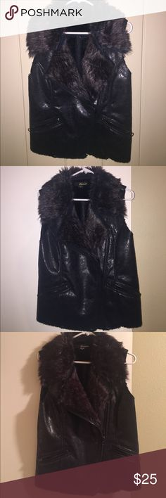 faux fur vest in dark brown/black Beautiful faux fur vest, dark brown & black fur lining & collar. Faux shinny distressed leather outside. Great condition. Adorable paired with jeans & winter boots. eivissa Jackets & Coats Vests