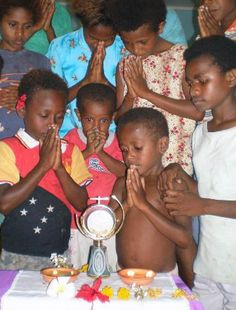 Children adoring Jesus in the Holy Eucharist...