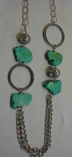 I love Turquoise cut like this. Such a fresh and natural look. Turquoise and metal long necklace by Razelle Troester