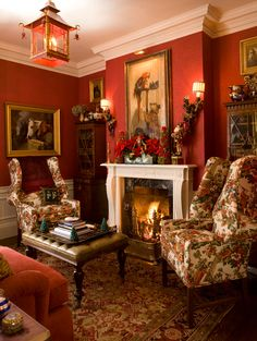 """This """"red room"""" is just that with deep red wallcovering and red accents on the upholstery and the rug. - Traditional Home ®/ Photo: John Bessler / Design: Anthony Catalfano"""