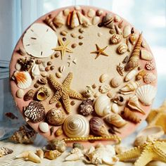 decorative shell plate...create a decorative plate to display seaside treasures.  Purchase a plate or charger from a craft or thrift store and hot glue the shells.