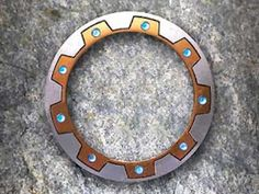 chakram, could slice off arms and legs with ease..NZ
