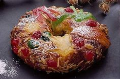 Bolo Rei - This cake is full of symbolism and can be found on every portuguese Christmas table. Legend tells that this cake represents the gifts offered to Baby Jesus by the Three Wiseman. The crust symbolizes gold, candied fruit representes myrrh, and the aroma of the cake symbolizes the incense.
