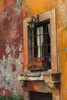 Peeling away the years, love the lantern over window, this could be done indoors also,