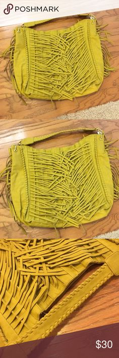 BIG BUDDHA large yellow fringe shoulder bag I've been helping clean out my mom's closet and all of these bags must go! She has always taken immaculate care of her bags (blemishes will be otherwise noted). Not sure about original prices of most of these because they were my mom's. Offers are much appreciated!  Individual bag description below: Yellow! Perfect condition! Feels like suede. Lots of fridge!!! Big Buddha Bags Shoulder Bags