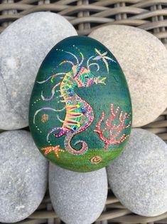 Seahorse on pebble Rock art by Ayse Sokullu