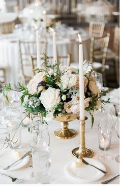 Idea: Round tables will a small floral arrangement surrounded by three to four brass candlesticks at various heights. Small votive candles in clear glad will be placed in between.