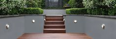 Around the pool - nice combo with wood, lighting , planter boxes and render.