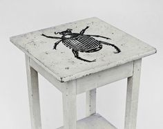 I don't even love insects that much, but I do love this kind of hand-painted art on simple things like side tables. from CREEP series   'beetle on white table' by deanbrowncreep, $375.00