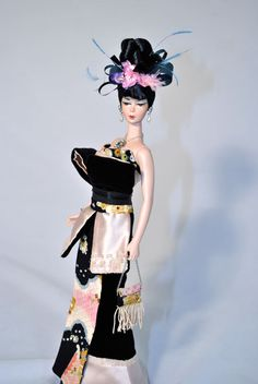 OOAK Barbie in an oriental inspiration wearing a silk black velvet dress with real Japaneese fabric for kimono, handembroidered with tiny beads and sequins and real Swarovski crystals. It's embellished with silk light peach duchesse handbeaded with transparent sequins. By Magia 2000.