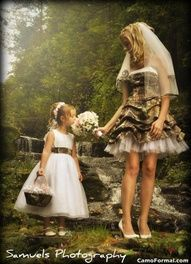Cutest camo wedding dress ive seen so far. Brides maids dresses with white brides gown.