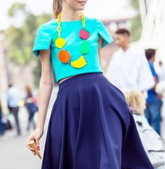 A full skirt with crop top and oversized fruit necklace is crazy fun // Photo: The Styleograph #MFW #streetstyle