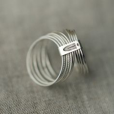 10 Candy twists silver stacking rings. €72.00, via Etsy.