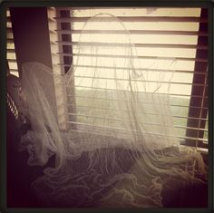 Easy, inexpensive, and spooky Halloween Cheesecloth Ghost How-To!