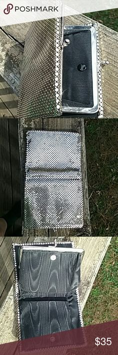 Vintage Metal mesh wallet . This is a gorgeous 1950s  silver vintage metal mesh wallet from Belgium. It is in very good condition .I got it from a estate sale years ago.I don't know much about it.It has several pockets inside of it and also a coin pocket inside of it. Bags Wallets