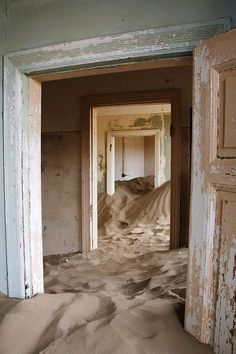 Kolmanskop, Namibia. A former diamond mining town in the Namib Desert where geological forces have buried many houses in sand.