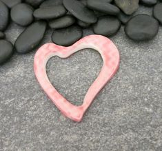 This sweet pink ceramic heart pendant features an open center, which echos the desire to be open hearted in one's relationships with others.