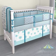 Crib bedding in Solid Mist, Mist and Gray Owls, Solid Turquoise, Aqua Mini Parquet, Aqua Dandelion, Aqua Dim Dots, Mist Zig Zag, Aqua Minky. Created using the Nursery Designer® by Carousel Designs where you mix and match from hundreds of fabrics to create your own unique baby bedding. #carouseldesigns