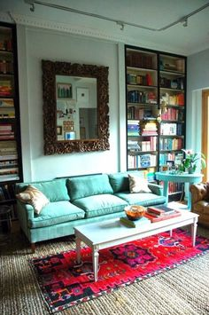 Turquoise, red, vintage mirror and lots of books.