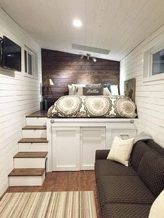Wandering on Wheels 2 - It's like the bed is on a mini deck with storage cabinets + drawers beneath. Better than plastic bed risers + plastic bins! Do I spy an open pet door in the side of the steps?
