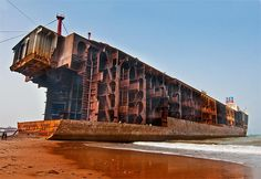 A hulking oil tanker stands with its bow removed on Gadani beach This particular ship had tons of steel. A ship this big take. Abandoned Ships, Abandoned Places, Ship Breaking, Oil Tanker, Merchant Marine, Tug Boats, Shipwreck, World Of Color, Urban Planning