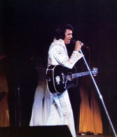 Elvis on stage - 1973. Unknown location. This jumpsuit was called the Pharoah…