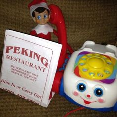 Tiny Elf on the Shelf calling in some Chinese food to go for Santa.... ♥