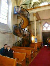 Loretto Chapel in Santa Fe.  Spiral staircase built without a center support or nails.  Chapel built to resemble the Sainte Chapelle in Paris.