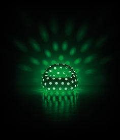 The effect of a light source under the object, creates patterns and causes light to diffuse