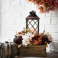 Create an elegant autumn centerpiece with our Natural Crate Lantern Centerpiece! With its warm glow, this lantern adds a little enchantment to your autumn days. Fall Lantern Centerpieces, Kitchen Centerpiece, Pumpkin Centerpieces, Lanterns Decor, Harvest Decorations, Thanksgiving Decorations, Seasonal Decor, Christmas Decorations, Holiday Decor
