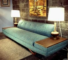 Mid century couch with  built-in  end tables.