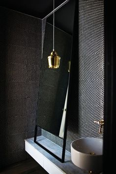 The powder room features dark penny-round tiles, a gold pendant light and a steel-rimmed mirror. Penny Round Tiles, Penny Tile, Modern Bathroom Design, Bathroom Interior Design, Bathroom Designs, Bathroom Ideas, Interior Modern, Kitchen Interior, Kitchen Design