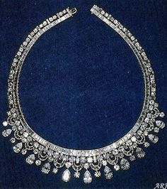 King Faisal Diamond Necklace. It was made in 1952 by Harry Winston and initially kept to showcase the firm's diamond jewelry collection. Fifteen years later, King Faisal of Saudi Arabia purchased the necklace and presented it to Queen Elizabeth during his state visit to Britain in May of 1967.