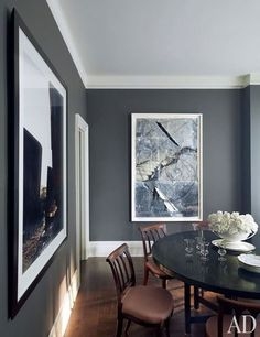 American fashion designer Kasper has long been an avid collector of contemporary art. The steel-gray walls of his Manhattan apartment's dining room beautifully offset works by Edward Burtynsky and Anselm Kiefer | http://archdigest.com