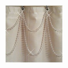 #0100S-DS-P    Elegant hand crafted shower curtain swag accessory. Add a Big touch of bling to your shower curtain. The pictures do not do it