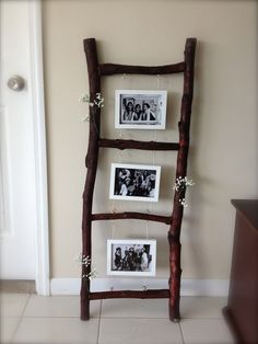 Rustic Picture Frame Ladder. Made this from branches I found outside. Sawed it for clean edges, stained it, nailed the branches together, screwed hooks at the top on bottom, and used twine to string it together. Bought accent flowers and attached it with hot glue gun. Rustic Decoration. Great job @Cassandra Vaque Fernandez. This looks amazing!