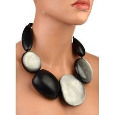 OK, I love big smooth pebble necklaces. I will just sit and enjoy looking at this. By Danish jewellers Gerda and Nicola Monies.  Leather, ebony and resin. More at: http://www.sanci.es/tienda/collares/67981993-collar-monies-negro.html