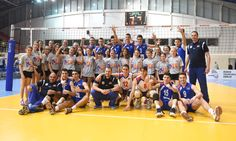 Junior men of Serbia celebrating with volunteers.