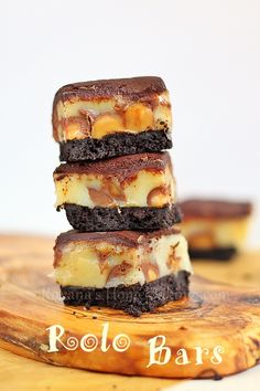Rolo Bars from Roxanashomebaking.com  Homemade Oreo crust, Rolo candies, caramel and chocolate ganache – it's a chocolate caramel heavenly delight