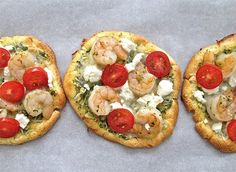 Top cloud bread with pesto, grape tomatoes, shrimp + goat or ricotta cheese to make tasty Cloud Bread Pizza.