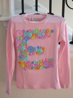 """100 day tshirt for school. 100 buttons glued with fabric glue as letter e for """"Eagles"""""""
