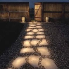 Painted stone walkway. Paint rocks with glow in dark paint.