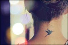 tattooideasdb:  Cute and lovely Hummingbird on neck!http://www.pairodicetattoos.com/black-hummingbird/