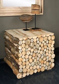Love this table of stacked logs @ Home Remodeling Ideas