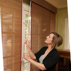 Woven wood sliding panels give your home exotic texture and cover sliding doors or french doors with ease. Keep your family safe by choosing #cordless blinds like these.