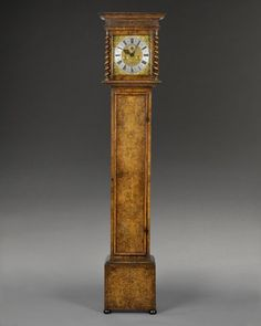 A fine & small William & Mary longcase clock.  The case constructed with deal & veneered with burr walnut of outstanding colour & good patination.  Standing on bun feet, the elegantly proportioned case has a long trunk door & rise-up hood flanked by barley twist columns.    The ten inch square brass dial is mounted with a silvered chapter ring signed by the maker & cherub and foliage spandrels...   Clockmaker: THOMAS JOHNSON at Ratcliff Cross fecit, London,   Circa: 1690,     Height: 77…